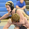(Brad Davis/The Register-Herald) Shady Spring's Levi Price, top, takes on Braxton County's Jordan Graham in a 132-pound weight class matchup during the Appalachian Fasteners Invitiational Saturday afternoon in Shady Spring. Shady's Price won the match.