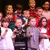 First graders at Maxwell Hill Elementary School, sang Christmas Don't be Late and Up On the Housetop during their annual Christmas performance held at Woodrow Wilson auditorium Monday morning. Music teacher Vickie Pachuta directed each class from pre-k to 5th grade to sing two christmas songs each along with sing alongs from the audience.<br /> (Rick Barbero/The Registewr-Herald)