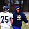Greenbrier West offensive line coach Isac Osbourne works with is line during football practice in Charmco on Tuesday. (Chris Jackson/The Register-Herald)