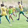 (Brad Davis/The Register-Herald) Young Tomorrow is Mine summer campers play soccer near the main playground area at Grandview Park during a Field Day event for participants Friday afternoon.