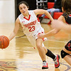 (Brad Davis/The Register-Herald) Greater Beckley Christian's McKenzie O'Neal hustles up the court as Oak Hill's Chelsea Pack defends Friday night in Prosperity.