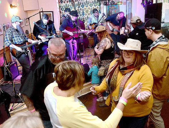 (Brad Davis/The Register-Herald) Music lovers dance and groove as The Wild Rumpus entertains the masses during WV PubFest Saturday evening at Weathered Ground Brewery. The event is a massive, annual music festival-styled gathering put together by area musicians, artists and brewers to benefit West Virginia Public Broadcasting.