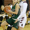 (Brad Davis/The Register-Herald) Wyoming East's Skylar Davidson drives to the basket along the baseline as Woodrow Wilson's Liz Cadle defends Saturday night in Beckley.
