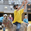 (Brad Davis/The Register-Herald) Nathan Mitchem gets his donkey in position for a shot as his team, the Buddy's Comancheros, take on the Jerusalem Cruisers during a donkey basketball tournament to benefit the Raleigh County Horseman's Association Sunday afternoon at the Beckley-Raleigh County Convention Center. The rules are simple, as it's basically standard basketball, but you must be on your donkey when taking a shot. You can dismount to pick up a loose ball or move around the court quicker, but you must have your donkey in tow at all times when not riding it. RCHA hopes to have a few more of these events in the future.