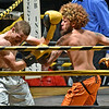 (Brad Davis/The Register-Herald) Eddie Smith, right, takes on Brandon Smith in a lightweight matchup during the Original Toughman Contest Friday night at the Beckley-Raleigh County Convention Center. Brandon Smith would win the fight.
