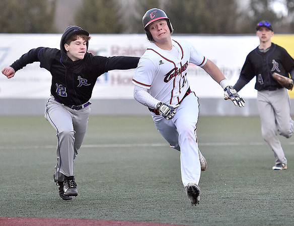 (Brad Davis/The Register-Herald) Greater Beckley Christian baserunner Andrew Patterson trys to evade the tag from River View infielder Conner Christian as he attempts to stretch a double into a triple after 3rd base was left briefly unmanned by Christian Friday evening at Linda K. Epling Stadium.