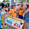 (Brad Davis/The Register-Herald) Oak Hill resident Misty Gill, far right, can barely speak as she's interviewed by 107.7 The River's Big Ugly after her name was drawn as the winner of the grand prize of a Disney Dream Vacation for four, the conclusion of the radio station's Summer Extravaganza Saturday afternoon at Hometown Kia. Hundreds came out to register for a chance to win the grand prize along with several other prizes, and Gill's name was last ticket standing at the end of all the other prize drawings.
