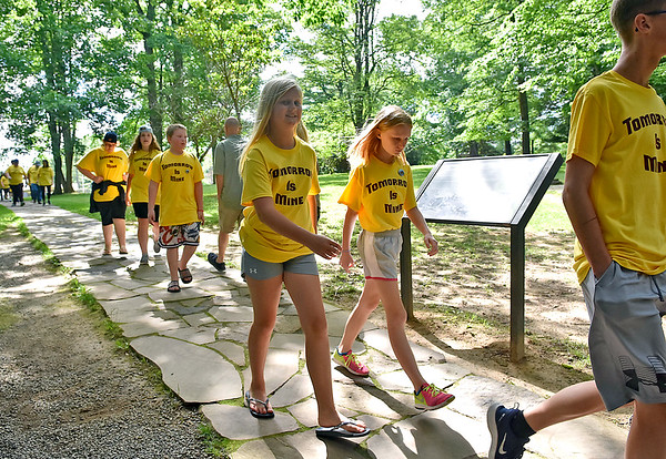 (Brad Davis/The Register-Herald) Young Tomorrow is Mine summer campers walk to the scenic overlook area at Grandview Park during a Field Day event for participants Friday afternoon.
