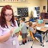 Crescent Elementary School first grade teacher Kayla Boyd preparing to teach her class.<br /> (Rick Barbero/The Register-Herald)