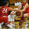 (Brad Davis/The Register-Herald) Greenbrier East's Kate Perkins scrums for a loose ball with Hurricane's Amiyah Donaldson, left, and Maddy Young Saturday night in Fairlea.