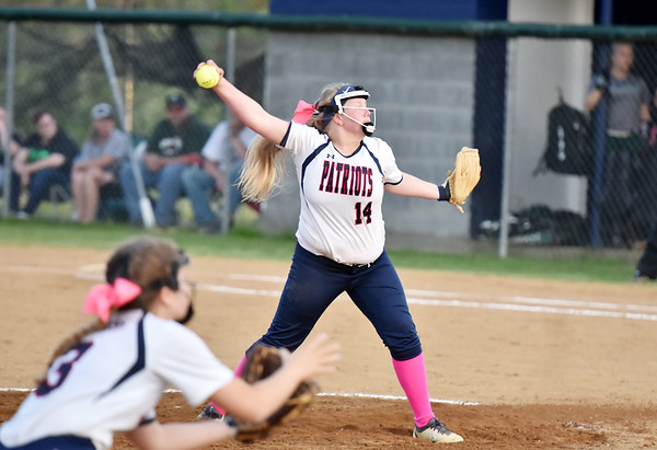 Independence's Savannah Bragg (14) delivers a pitch during their Class AA, Region 3, Section 1 softball game against  in Coal City on Tuesday. (Chris Jackson/The Register-Herald)