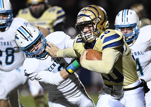 Drew Clark, of Shady Spring, right, stiff arms Preston Dingess, of Mingo Central, for some extra yards during the first half of the first round playoff game held at Shady Spring High School.<br /> (Rick Barbero/The Register-Herald)
