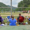 (Brad Davis/The Register-Herald) Residents and family members take in the action at the the Big Coal River Little League fields a pair of softball teams warm up Saturday afternoon in Pettus.