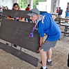 (Brad Davis/The Register-Herald) Scouts and other support staff begin breaking down tables and tents during the last day of World Scout Jamboree activities Thursday afternoon at the Summit Bechtel Reserve.