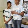 (Brad Davis/The Register-Herald) Nine-year-old Jahari Keith and his mother LaKeisha Barron-Brown greet attendees and speak briefly about their mission with Hearts United as a CPR training course in memory of Jahari's late father Brian gets underway at the First Baptist Church on Braodway Street in Oak Hill Saturday morning.