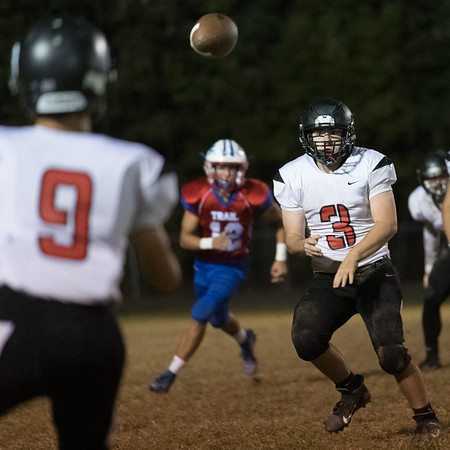 Issac Atkins of Liberty makes a pass to John Tabor. Chad Foreman for the Register-Herald.