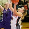 (Brad Davis/The Register-Herald) Summers County's Bethani Cline drives to the basket as River View's Trista Lester defends Saturday night in Hinton.