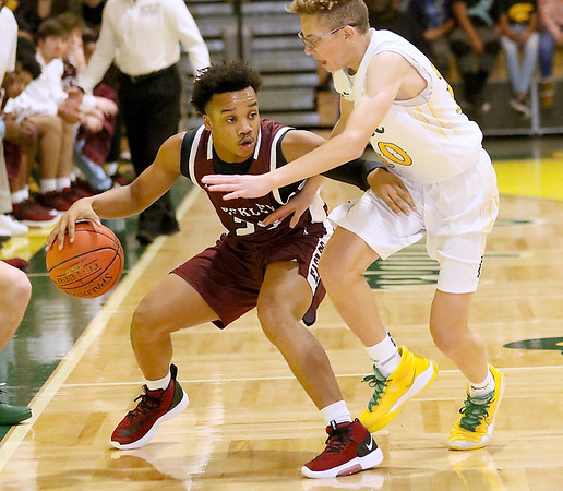 (Brad Davis/The Register-Herald) Woodrow Wilson's Richard Law maintains possession as he's pressured by Greenbrier East's Adam Seams Friday night in Fairlea.