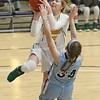 (Brad Davis/The Register-Herald) Greenbrier East's Haley McClure drives and scores as Spring Valley's Caroline Asbury defends during Big Atlantic Classic action Wednesday night at the Beckley-Raleigh County Convention Center.