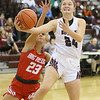 (Brad Davis/The Register-Herald) Woodrow Wilson's Liz Cadle drives and scores as Parkersburg's Emily Kupfner defends Saturday afternoon in Beckley.
