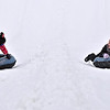 (Brad Davis/The Register-Herald) Best friends Alyssa Starnes (left), 9, and Bryn Holden, 10, both from North Carolina, get into a friendly shouting match over who won after the two finished up another run down the snow tubing track at Winterplace Saturday evening. If you were looking forward to playing in some snow, Winterplace was the only place to find it, as a winter storm system moving through the area largely spared us of any real accumulation.