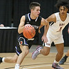 (Brad Davis/The Register-Herald) Princeton's Cade Fix drives around South Charleston's Darius Dawson at the perimeter during Big Atlantic Classic action Friday afternoon at the Beckley-Raleigh County Convention Center.