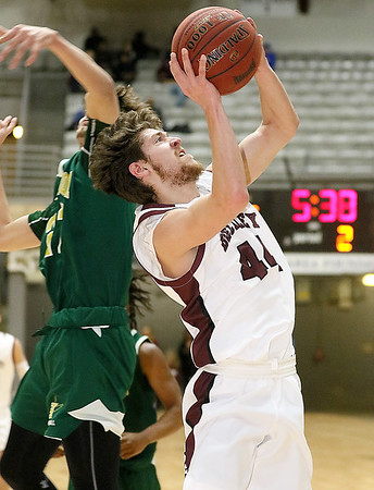 (Brad Davis/The Register-Herald) Woodrow Wilson's Danny Bickey drives and scores as Huntington's Tanner Stevens misses the block attempt Wednesday night at the Beckley-Raleigh County Convention Center.