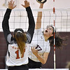 (Brad Davis/The Register-Herald) Woodrow Wilson's Elysia Salon spikes the ball as St. Albans' Lauren Rasberry defends during the Class AAA Region 3 championship tournament Saturday evening in Beckley.