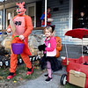 (Brad Davis/The Register-Herald) Audrey Gibson (cat), Riley Blake (left) and others in their group set out for Trick or Treating along the Crescent Road neighborhood area as Hailey Blake (porch) will handle candy distributing duties Saturday evening in Beckley.