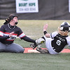 (Brad Davis/The Register-Herald) Westside baserunner Rachel Toler is tagged out at 2nd base by Oak Hill infielder Kaylee Mann Wednesday evening in Oak Hill.