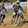 (Brad Davis/The Register-Herald) Riders battle for position through a tight corner during the GNCC racing event Saturday afternoon at the Summit Bechtel Reserve.