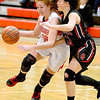 (Brad Davis/The Register-Herald) Greater Beckley Christian's Grace Mitchell starts a drive along the perimeter as Oak Hill's Chelsea Pack defends Friday night in Prosperity.