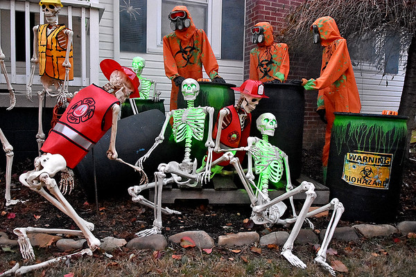 (Brad Davis/The Register-Herald) It's a different skeleton scene each year in the yard of Orachard Avenue residents Steve and Debroah Atha.