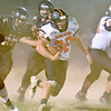 (Brad Davis/The Register-Herald) Summers County ball carrier Trent Meador emerges from cloud of dust and a host of Liberty defenders to pick up a chunk of yards on the ground during the Bobcats' road win over the Raiders Friday night in Glen Daniel.