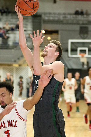 (Brad Davis/The Register-Herald) Wyoming East's Roy Hood Jr. drives and scores as Oak Hill's Abraham Farrow defends during Big Atlantic Classic action Wednesday night at the Beckley-Raleigh County Convention Center.