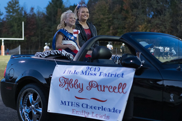 Little Miss Patriot, Abby Parcell and Midland Trail cheerleader, Emily Lewis ride in the homecoming parade. Chad Foreman for the Register-Herald.