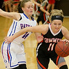 (Brad Davis/The Register-Herald) Summers County's Taylor Isaac works around Midland Trail's Kyleigh Jackson Wednesday night in Hico.