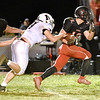 (Brad Davis/The Register-Herald) Liberty's Logan Dodrill breaks free for a nice gain on the ground as Independence defender Hunter Williams reaches out to grab him Friday night in Glen Daniel.