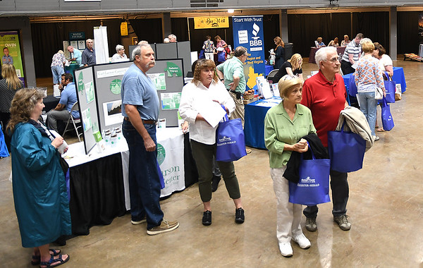 """Seniors listening to announcements during, """"Senior Day Out"""" held at Beckley-Raleigh County Convention Center. The event had, music bingo, vendors, door prizes, information about products and services for our senior community and was co-sponsored by, The Register-Herald and Raleigh County Commission on Aging.<br /> (Rick Barbero/The Register-Herald)"""