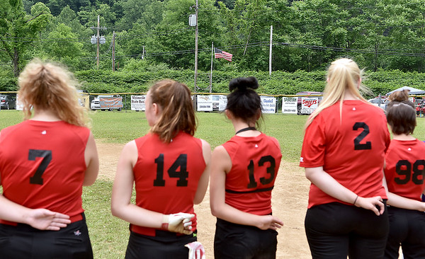 (Brad Davis/The Register-Herald) Softball players line up for the national anthem prior to the start of the days games at the Big Coal River Little League Fields Saturday afternoon in Pettus.