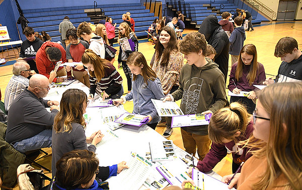 "Students at Shady Spring Middle School lined up to purchase homes  during the, ""Get a Life"" program sponored by the State Treasurer's office and Raleigh County Chamber of Commerce. The program teaches students how to better prepare themselves with finances after graduating from school.<br /> (Rick Barbero/The Register-Herald)"