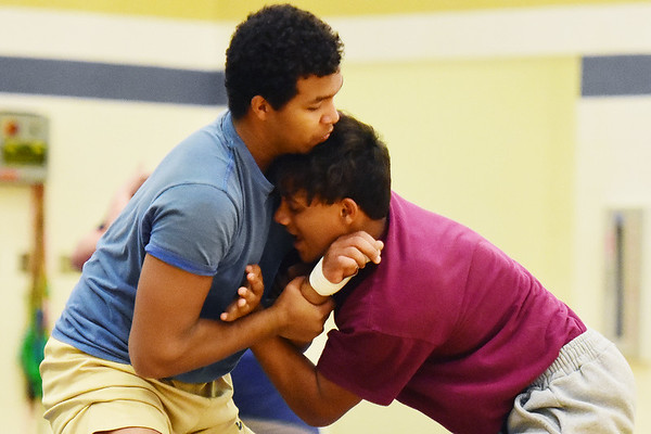 Greenbrier West's Marshall Clere and Mylik Cox work on their wrestling moves during practice in Charmco on Tuesday. (Chris Jackson/The Register-Herald)