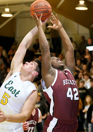 (Brad Davis/The Register-Herald) Woodrow Wilson's Mykel McDowell leaps for a rebound with Greenbrier East's Peyton Pack Friday night in Fairlea.