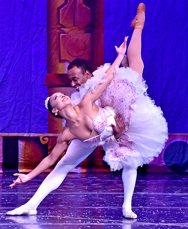 (Brad Davis/The Register-Herald) Sugar Plum Fairy Stephanie Ray Williams and Cavalier Dustin James perform together during a scene from Beckley Dance Theatre and Beckley Performing Arts' presentation of The Nutcracker Sunday afternoon inside the Woodrow Wilson High School Auditorium.