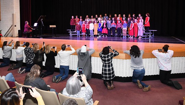 """Fifth graders at Maxwell Hill Elementary School, sang """"Carol of the Bells, Whits Christmas and Silent Night, during their performance held at Woodrow Wilson auditorium Monday morning. Music teacher Vickie Pachuta directed each class from pre-k to 5th grade to sing two christmas songs each along with sing alongs from the audience.<br /> (Rick Barbero/The Registewr-Herald)"""