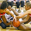 (Brad Davis/The Register-Herald) Woodrow Wilson's Victoria Staunton grapples for a loose ball with Parkersburg's Emily Kupfner, right, and Bre Wilson Saturday afternoon in Beckley.