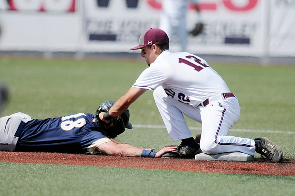 Concord's Anthony Stehlin (12) tags out Shepherd's Christian Hamel (18) after Concord's pitcher Troy Beckner threw him out during their MEC baseball game in Beckley on Friday. (Chris Jackson/The Register-Herald)