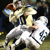 Drew Clark, of Shady Spring, left, gets brought down by, Westan Christian, of Mingo Central fduringthe first half of the first round playoff game held at Shady Spring High School.<br /> (Rick Barbero/The Register-Herald)