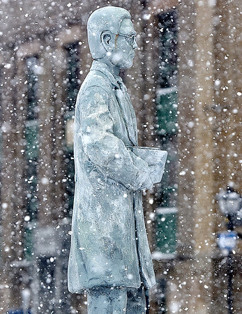 (Brad Davis/The Register-Herald) Another burst of afternoon snow showers hit Beckley Sunday.