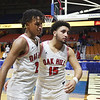 Oak Hill's Michael Beasley (2) and Khori Bass (15) walk off the court together after their West Virginia State Championship Class AA Quarter Finals loss to Robert C. Byrd in Charleston on Thursday. (Chris Jackson/The Register-Herald)